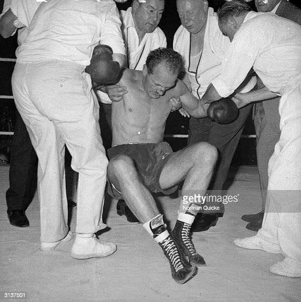 British boxer Henry Cooper is knocked out by Floyd Patterson in the 4th round at Wembley Arena London