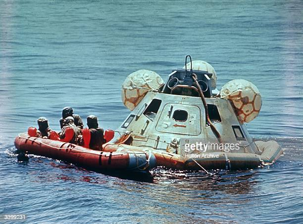 Divers recover the Apollo 12 command module in the Gulf of Mexico