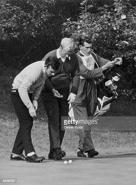 Golfing rivals Tony Jacklin of Britain and Jack Nicklaus of the USA marking their balls after they had played their shot within inches of each other...