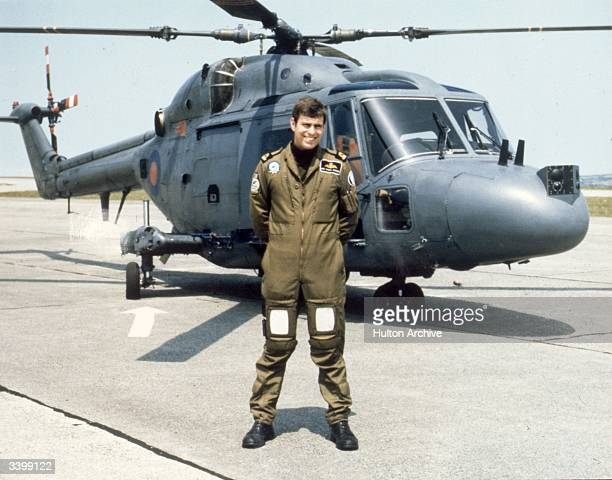 Prince Andrew, the Duke of York, at Naval Air Station Portsmouth, in front of a Westland Navy Lynx helicopter.