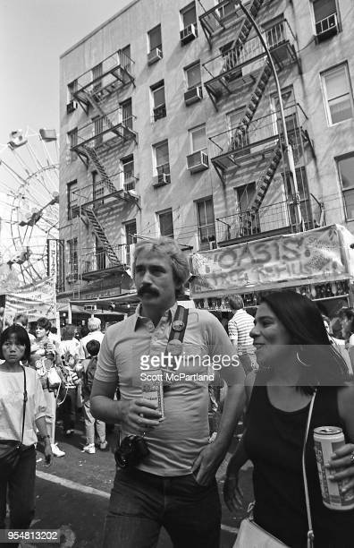 New York City A couple stands on the street and drinks beer out of a can during the annual Feast Of San Gennaro Festival in Little Italy