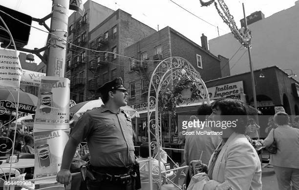 New York City A police officer stands guard and assists people at the annual Feast Of San Gennaro Festival in Little Italy
