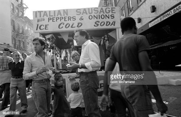 New York City People stop and grab a bite to eat at a food cart during the annual Feast Of San Gennaro Festival in Little Italy