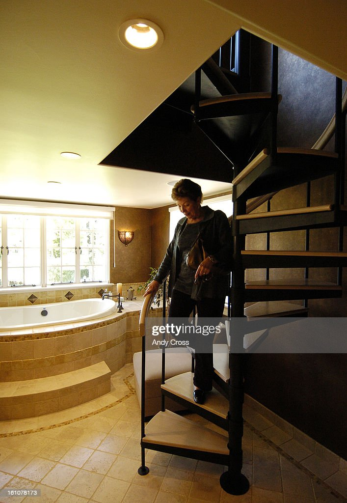 DENVER, CO  SEPTEMBER 20TH  2006  Julie Hummel, A Broker Walks Down A Spiral  Staircase In A Bath Spa Area On The Second Floor Of The Berger Mansion, ...