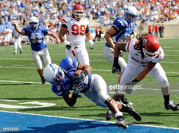 COLORADO SPRINGS COLORADO SEPTEMBER 20TH2008Kyle Lumpkin #28 Air Force Falcons scores a touchdown against Kepa Gaison #59 right Utah Utes in the...