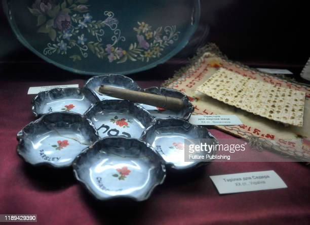 VINNYTSIA UKRAINE DECEMBER 17 2019 A 20thcentury Passover Seder plate and a device for cutting matzah are displayed at the Vinnytsia Regional Museum...