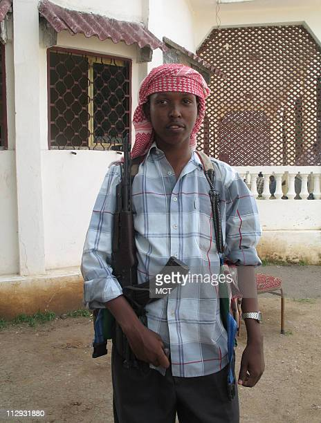 A 20yearold gunman from the Islamic Courts Union militia poses with gun outside the group's headquarters in Mogadishu Somalia He declined to give his...