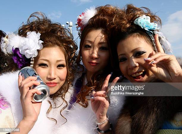 Year-old Japanese women dressed in traditional kimonos pose for a picture during the Coming of Age Day at Cultural Hall on January 9, 2012 in Himeji,...