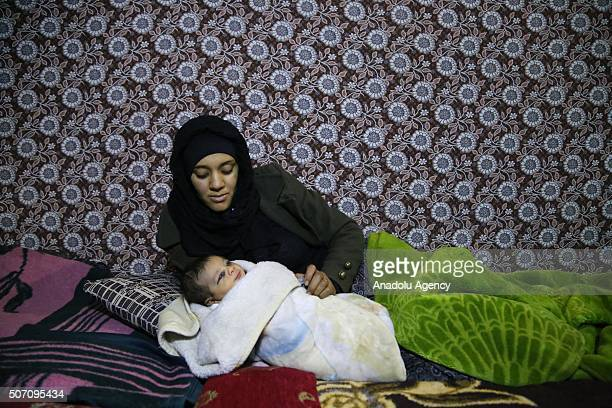 20yearold Nesrin Gilif raises her first baby after escaping from Syria due to ongoing civil war as they continue their lives at their tiny home with...