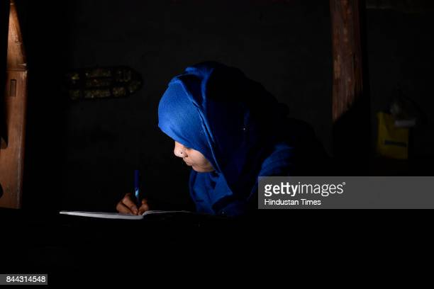 20yearold Rohingya Muslim refugee Tasmida studies inside her shanty on September 6 2017 in New Delhi India She says that the Indian government must...