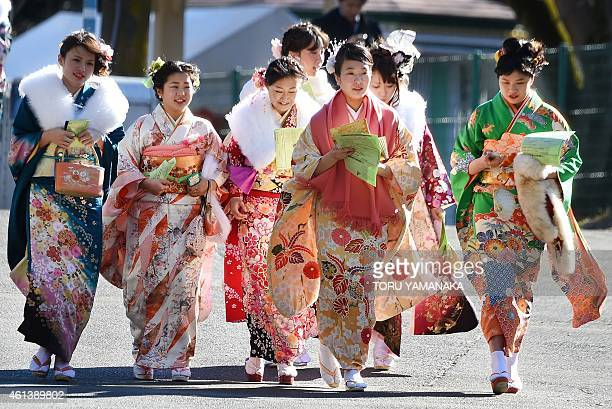 """Year-old women wearing kimonos attend a """"Coming-of-Age Day"""" celebration at the Toshimaen amusement park in Tokyo on January 12, 2015. The number of..."""