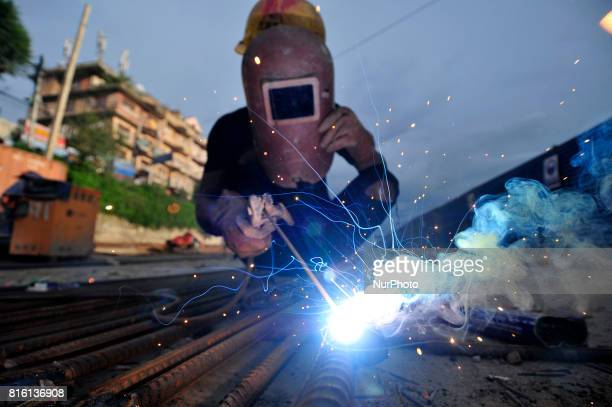 CHAUDHARY 20yrs old migrated from sunsari welding iron piler for ongoing Bridge expansion work supported by China AID at Kalanki Kathmandu Nepal on...