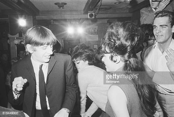 2/10/1964New York NY Mophaired Ringo Starr one of Britain's Beatles tries the twist with dancer Pauline Klaire at the Peppermint Lounge late February...