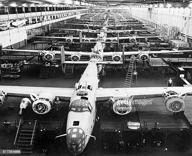 Huge B24 bombers are shown lined up on the final assembly line at Henry Ford's Willow Run plant here This picture is one of the first of a series of...