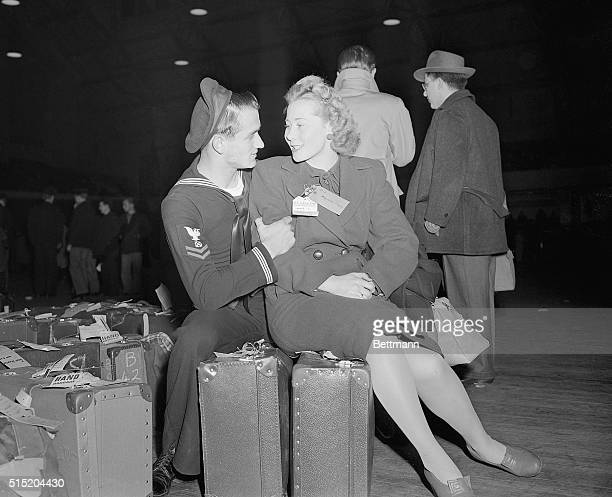 2/11/1945New York NY James McGuiness still in the Navy welcomes his British war bride at the Seventh Regiment Armory where brides and babies who...