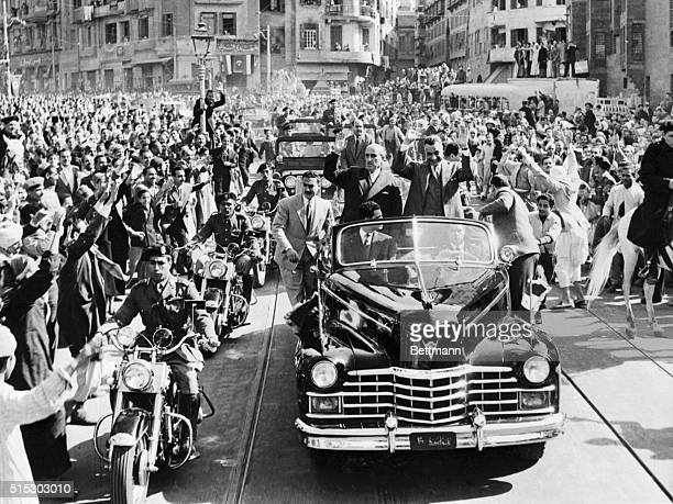 2/1/1958Cairo Egypt Cheering crowds surround the car in which Egyptian President Gamel Abdel Nasser and Syrian President Shukri alKuwatly ride to the...