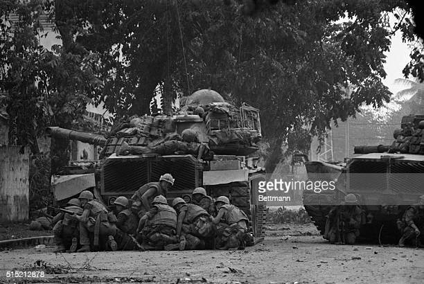 2/1/1968Hue South Vietnam US Marines take cover behind a tank in Hue 2/1 after Viet Cong terrorists snipers opened fire on them The Marines along...