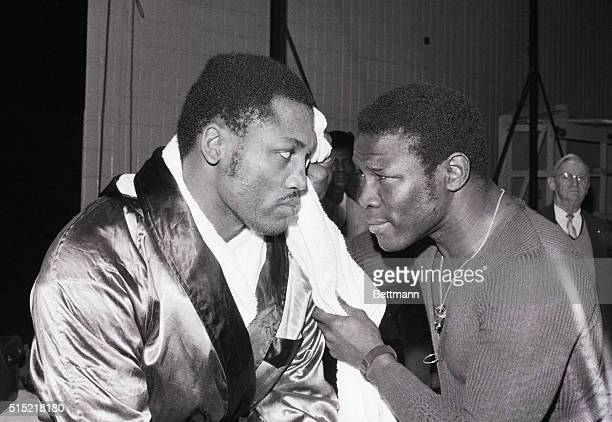 2/1/1970New York NY With a little help from his pal twotime world middleweight boxing champion Emile Griffith Joe Frazier cools off after training at...