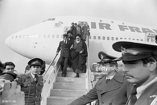 Tehran, Iran- Ayatollah Ruhollah Khomeini, Iran's main opposition leader, is shown stepping down the Air France plane which brought him to Tehran...
