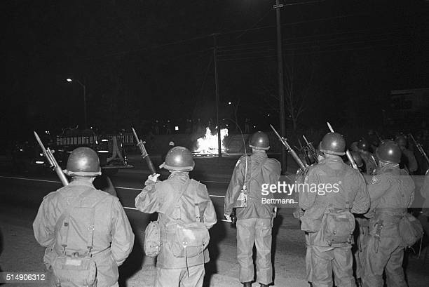 2/12/1968Orangeburg SC National Guardsmen with fixed bayonets back up highway patrolmen who charged firebombthrowing Negro students near the main...