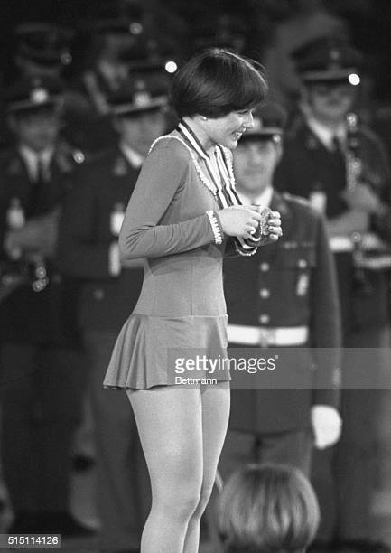 Innsbruck, Austria- A beaming Dorothy Hamill clutches her Gold Medal as the American National Anthem is played at the ceremonies after the...