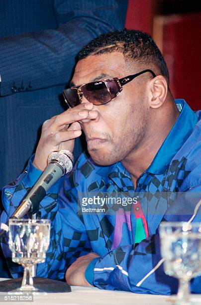 2/13/1990New York NY Exheavyweight champion Mike Tyson is shown holding his nose at a press conference here 2/13 Tyson who lost his title to James...