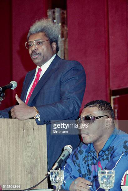 2/13/1990New York NY Exheavyweight champion Mike Tyson listens as promoter Don King addresses a press conference here 2/13 Tyson who lost his title...