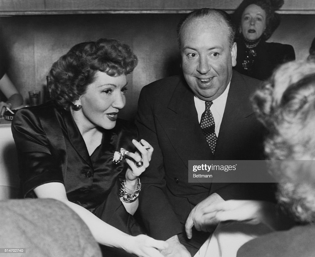 Famed producer Alfred Hitchcock enjoys the charming company of film actress Claudette Colbert at the Stork Club. Miss Colbert has told a good one from the expression of the face of Hitchcock.