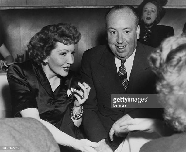 2/14/1946New York NY Famed producer Alfred Hitchcock enjoys the charming company of film actress Claudette Colbert at the Stork Club Miss Colbert has...