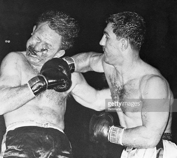 Philadelhia, PA- Unbeaten Rocky Marciano , 27-year-old heavyweight contender from Brockton, MA, lashes out in a fierce, blood-spattering attack on...