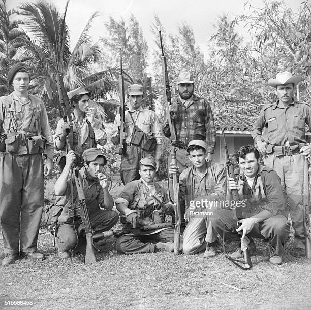 2/14/1961Trinidad CubaA mixed team of soldiers and militiamen are shown at base camp on a confiscated plantation near here after returning from 'the...
