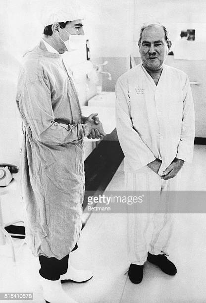 2/14/1968Cape Town South Africa Posing for pictures for the first time since his heart transplant operation dentist Philip Blaiberg stands beside Dr...