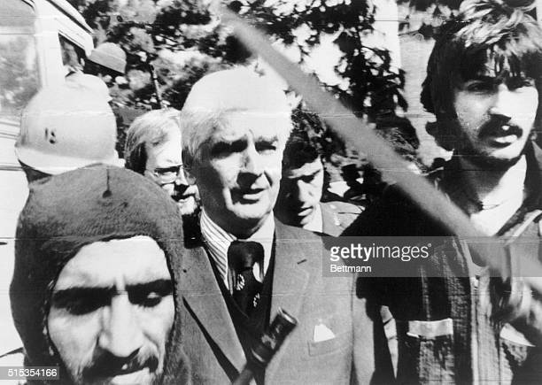 Tehran, Iran- US Ambassador, William Sullivan, is is escourted by armed guerrillas brandishing bayonets after he was taken prisoner at the US...
