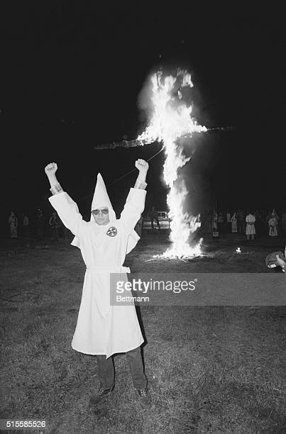 2/14/1981Santa Fe TX A member of the Ku Klux Klan rasies his fist during a crossburning in support of American fishermen along the Texas coast The...