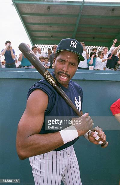 Fort Lauderdale, FL-New York Yankee outfielder Dave Winfield shows off his batting arm while he clowns around with photographers duirng spring...