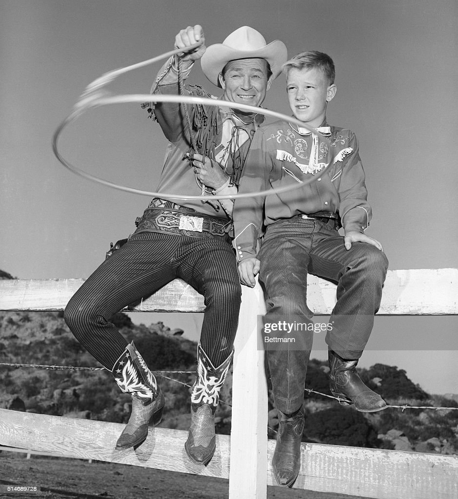 Roy Rogers Shows Son His New Invention : News Photo