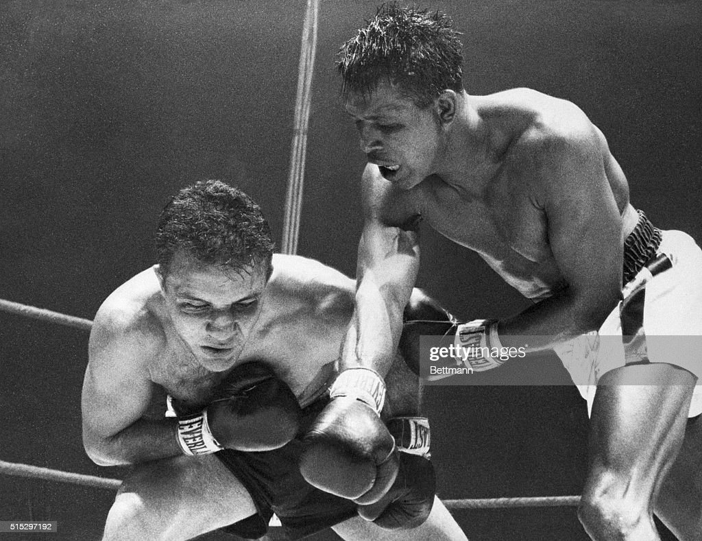 Chicago, IL- Striking with the fury of a tiger and the cunning of a fox, Ray Robinson presses his attack to the head of Jake LaMotta in the last round of their battle for the middleweight championship.