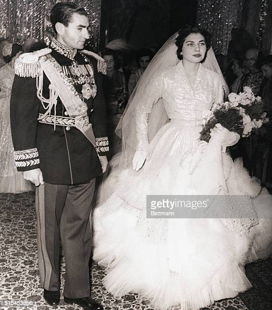 2/15/1951Teheran IranCarrying a bouquet of carnations newlywed Soraya Isfandiari poses with her husband the Shah of Iran after the religious ceremony...