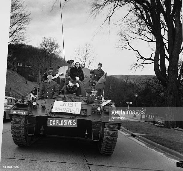 2/16/1952West Point NY An old artillery tradition was revived at West Point today with this happy photo of newlyweds Sargent Fred Elam of Nashville...