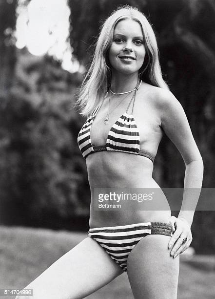 Sydney, Australia: Shapely Anne Heywood has the right gear for keeping cool on a hot and humid day, as she enjoys beach outing here.