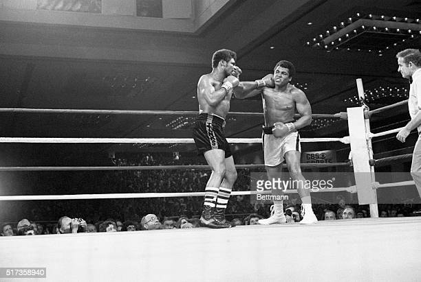 Las Vegas, NV- Muhammad Ali takes a left jab from Leon Spinks in the 12th round of their 15 round title bout at the Las Vegas Hilton Pavilion here in...