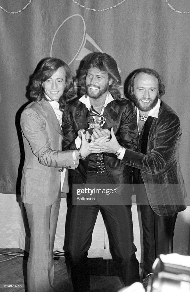 The Bee Gees Smiling, Holding Grammys : News Photo