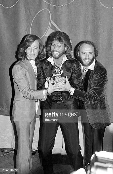 2/16/1979Los Angeles CA Grammy winners 2/15 the Bee Gees brothers Robin Barry and Maurice Gibb hold their Grammy for their Album of the Year Award...