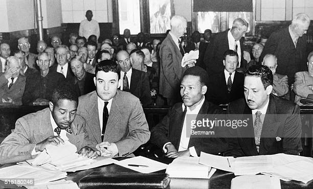 Seated in the crowded courtroom during the second trial of Walter Lee Irvin are Left to Right Paul C Perkins Jack Greenberg New York attorney for the...