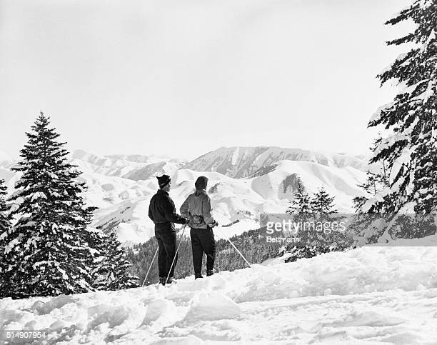 2/18/1952Sun Valley Idaho High on Sun Valley's Baldy Mountain two skiers pause to absorb some of the quiet grandeur of the panorama of the mountains...