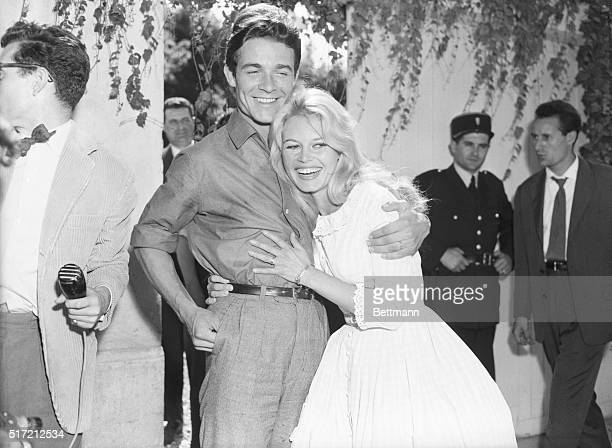 2/18/1959Louveciennes France Actress Brigitte Bardot gets a hug from her new husband actor Jacques Charrier also 23 following their wedding here June...
