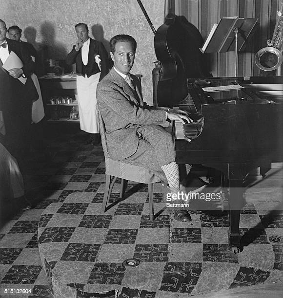Miami Beach, FL- George Gershwin, foremost, present-day, music composer, is seen here at the piano, at the Deauville pool where he is vacationing.