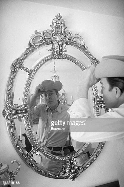 2/19/1966Fully attired in western garb singer Jimmy Dean makes a final check in the mirror