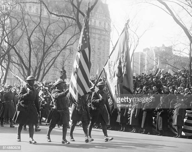 369th Colored Infantry parade down 5th Avenue Regiment colors on display passing review stand