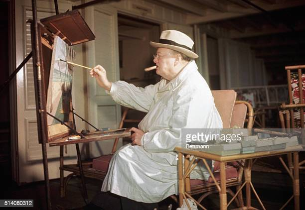 Winston Churchill engrossed in his hobby of oil painting at Miami Beach FL